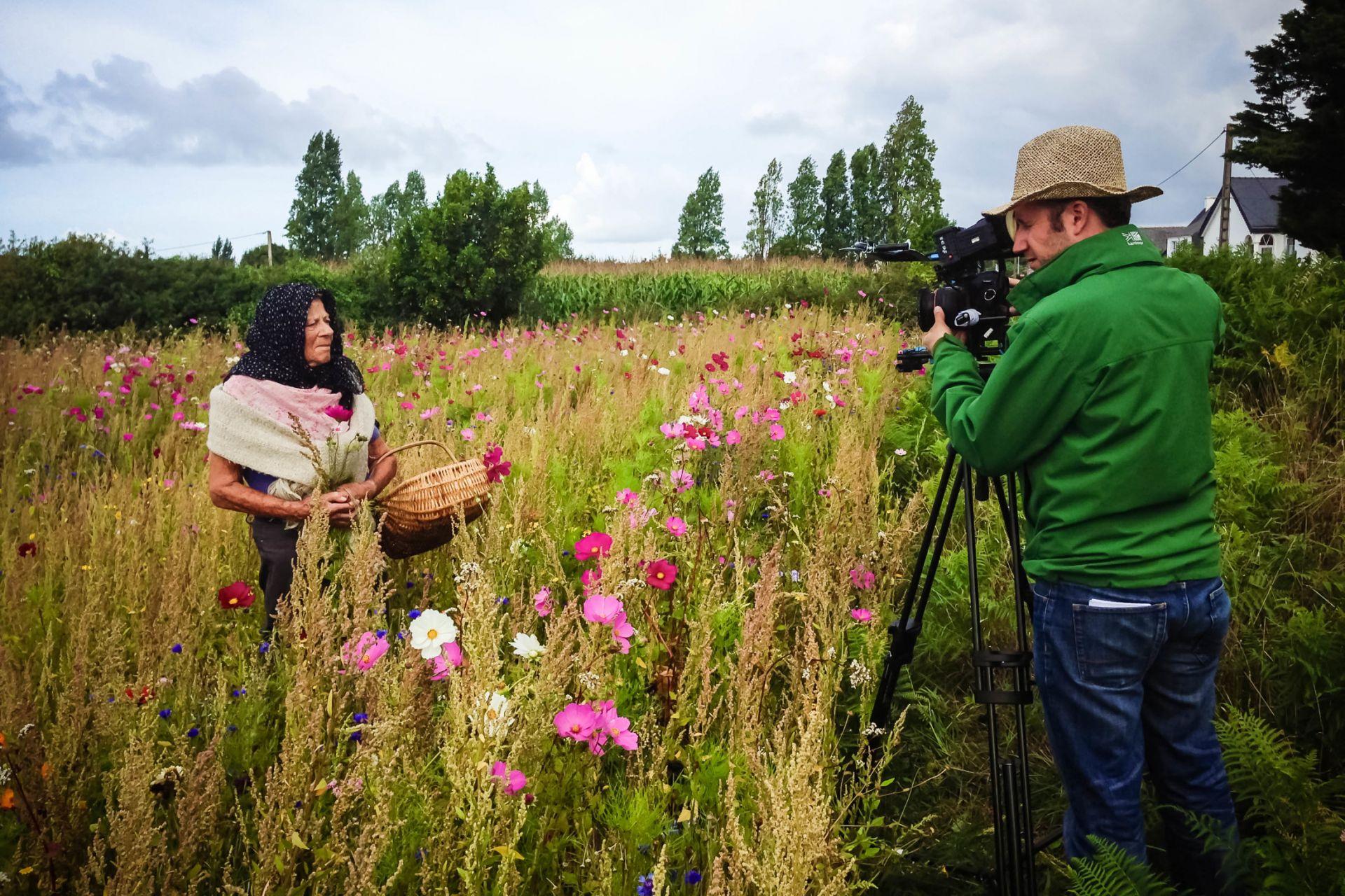 Cameraman filming in garden