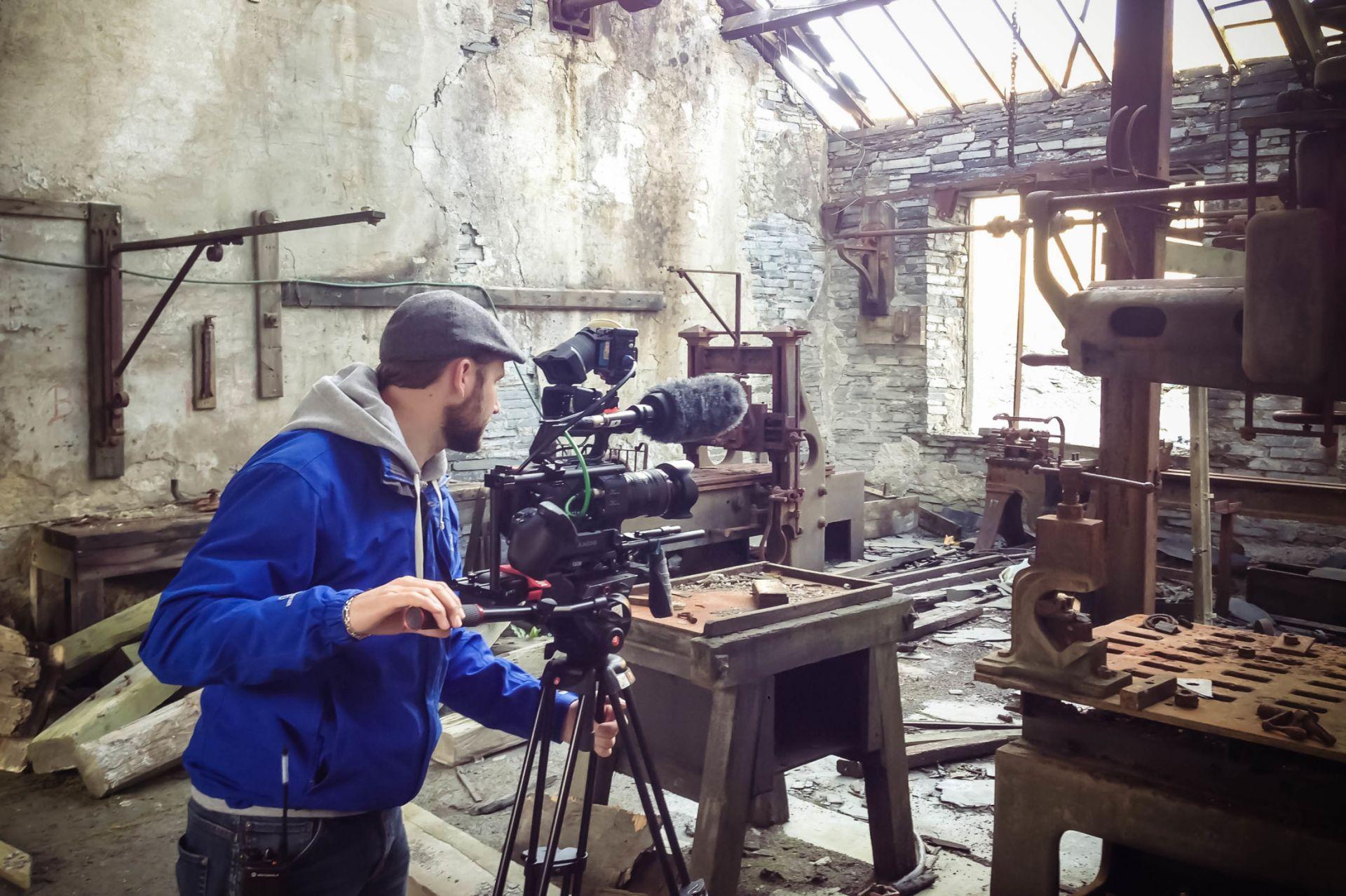 Cameraman filming in warehouse